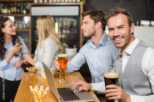 Fototapety, obrazy: Men working on laptop while women talk behind