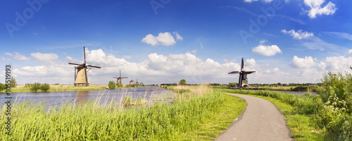 Fotografie, Obraz  Traditional Dutch windmills on a sunny day at the Kinderdijk