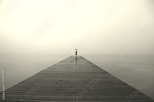 woman with black umbrella looking infinity in a surreal place Canvas Print