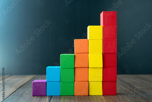 Photo Colorful stack of wood cube building blocks