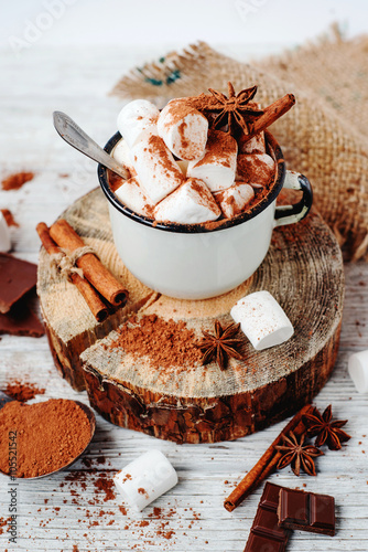 Printed kitchen splashbacks Chocolate delicious winter hot drink cocoa with marshmallow , cinnamon , chocolate , spices and milk on a white wooden background