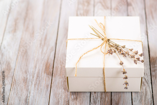 Fotografía  White Present box with rustic twine and sprig of lavender