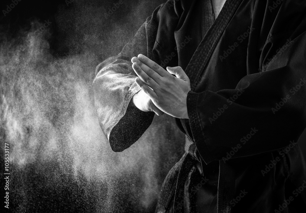 Photo  Closeup of male karate fighter hands. Black and white.