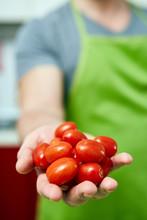 Chef Holding Cherry Tomatoes