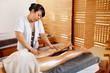 Spa Woman. Aromatherapy Oil Leg Massage Therapy. Masseur Massaging Sexy Young Long Female Legs In Cosmetology Salon. Beauty Treatment Concept. Relaxing Body Procedure. Skin Care, Wellness, Lifestyle