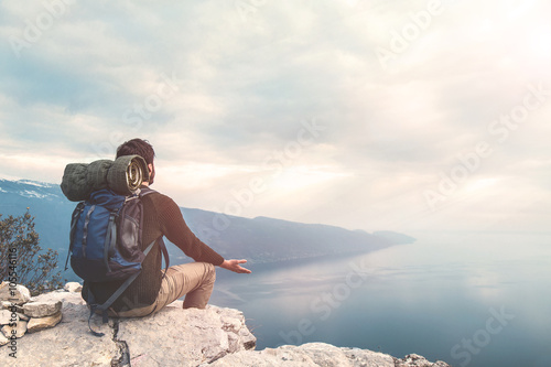 Fotografie, Obraz  climber meditating on the top of the mountain