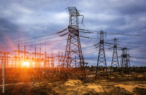 Valokuva  cascade of high-voltage at beautiful  landscape at sunset.
