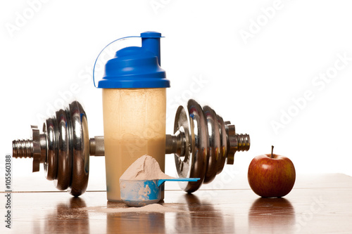 Fotografie, Obraz  Whey protein powder in scoop, dumbbell, meter tape and plastic s