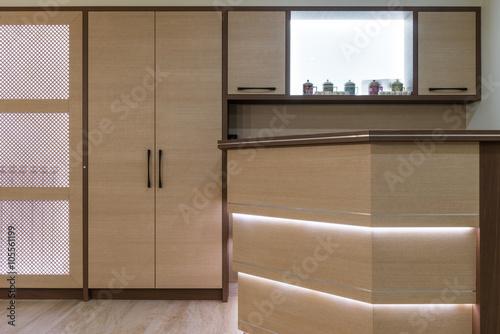 Little wooden kitchen with bar in home interior – kaufen Sie dieses ...