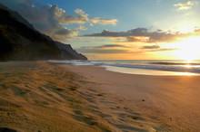 Secluded Kalalau Beach On The Na Pali Coast Of Kauai, Hawaii At Sunset