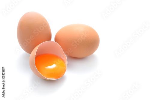 Fotografie, Obraz  Close up of cracked egg isolated on white background