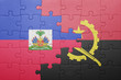 canvas print picture - puzzle with the national flag of angola and haiti
