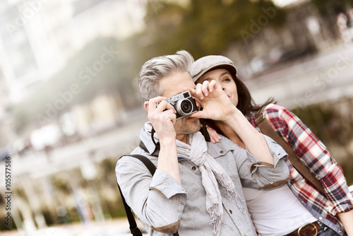 Couple of tourists taking pictures of sightseeing Fototapeta