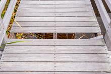 Damaged Or Broken Wooden Bridge Or Walkway.