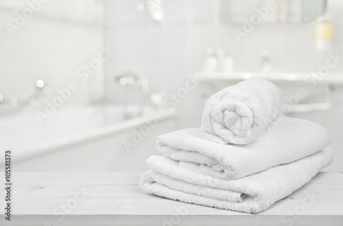 Fotografie, Obraz  Stack of folded white spa towels over blurred bathroom background