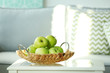 Ripe green apples on a table in the room