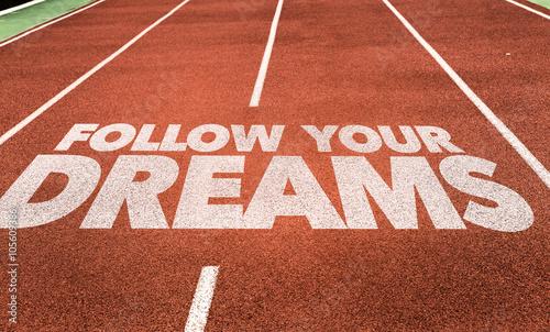 Follow Your Dreams written on running track Wallpaper Mural