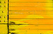 Brightly colored yellow orange wood background