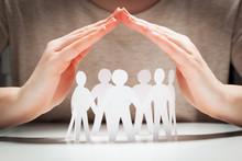 Paper People Under Hands In Ge...