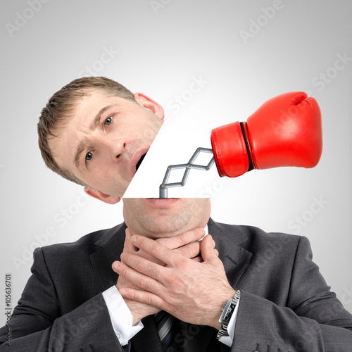 Fényképezés  Boxing glove beating from businessmans head