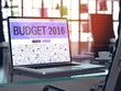 Budget 2016 Concept. Closeup Landing Page on Laptop Screen in Doodle Design Style. On Background of Comfortable Working Place in Modern Office. Blurred, Toned Image. 3D Render.