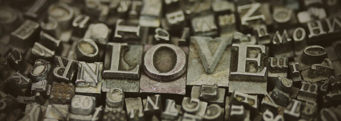 Panel Szklany Close up of typeset letters with the word Love