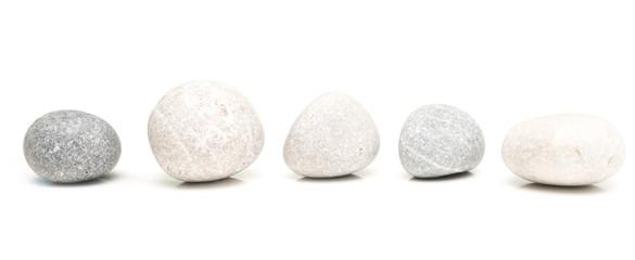 Fototapeta na wymiar round stones on white