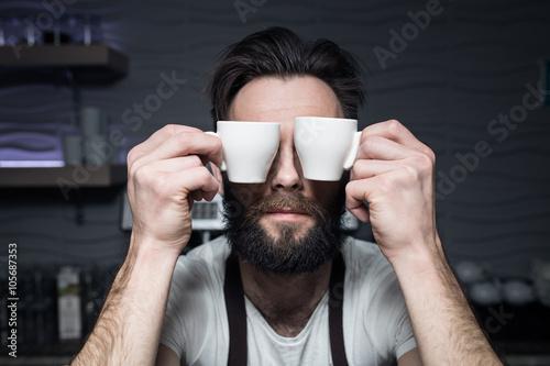 Fotografie, Obraz  bartender keeps cups of coffee near face;