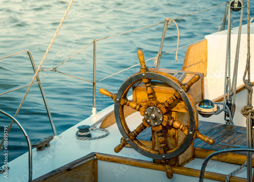 Photo Steering wheel on the yacht.
