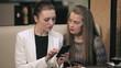 Two young businesswomen meet in restaurant