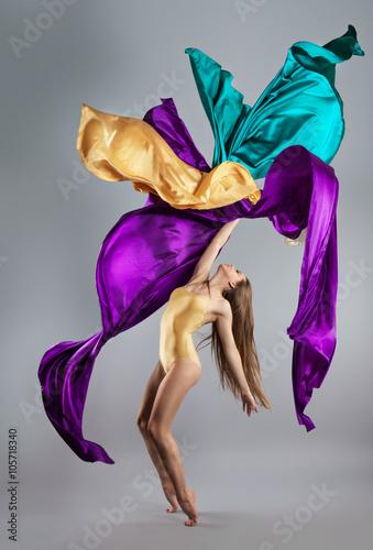 Plakat  beautiful young girl dancing. Flowing fabric.