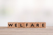 canvas print picture - Welfare sign made of wooden cubes