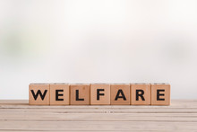 Welfare Sign Made Of Wooden Cubes