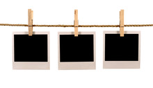 Several Blank Polaroid Style Instant Photo Print Frames Hanging On String Or Washing Line