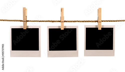 Fotografie, Obraz  Several blank polaroid style instant photo print frames hanging on string or was