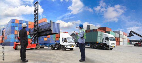forklift handling the container box at dockyard Canvas Print