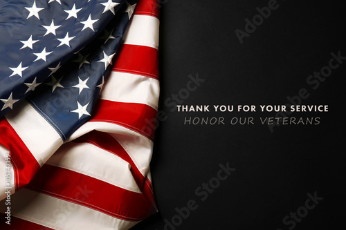 Text Thank You For Your Service on black background near American flag