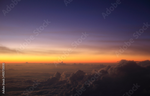 фотография  A pre-dawn sky above the clouds over Indonesia taking during a flight at 35,000ft