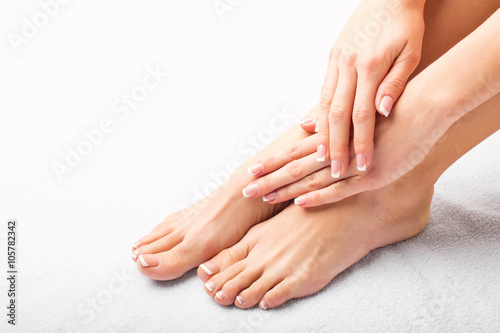 Woman after manicure and pedicure