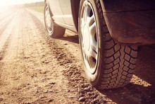 Car Tire On Dirt Road