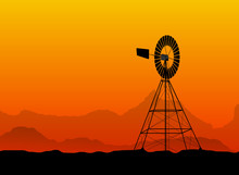 Silhouette Of A Water Pumping Old Windmill, Windmill Water Tower At The Desert