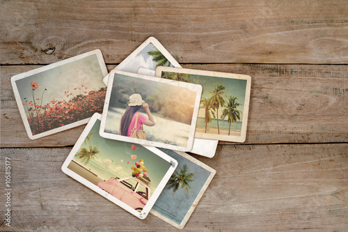 Summer photo album on wood table Canvas-taulu