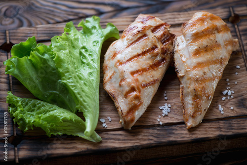 Canvas Prints Fish Closeup of grilled chicken breasts served with fresh green salad