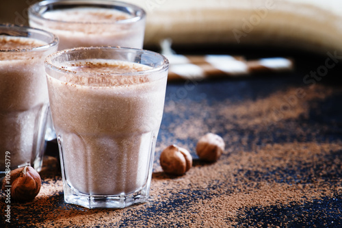 Photo Stands Milkshake Banana nut smoothie with chocolate, selective focus