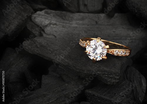 fototapeta na szkło jewelry ring witht big diamond on dark coal background, soft foc