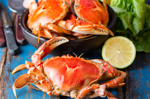 Poster Schaaldieren Seafood. Bowl of crabs on wooden blue background. Traditional food on Holy week Easter in Latin America.