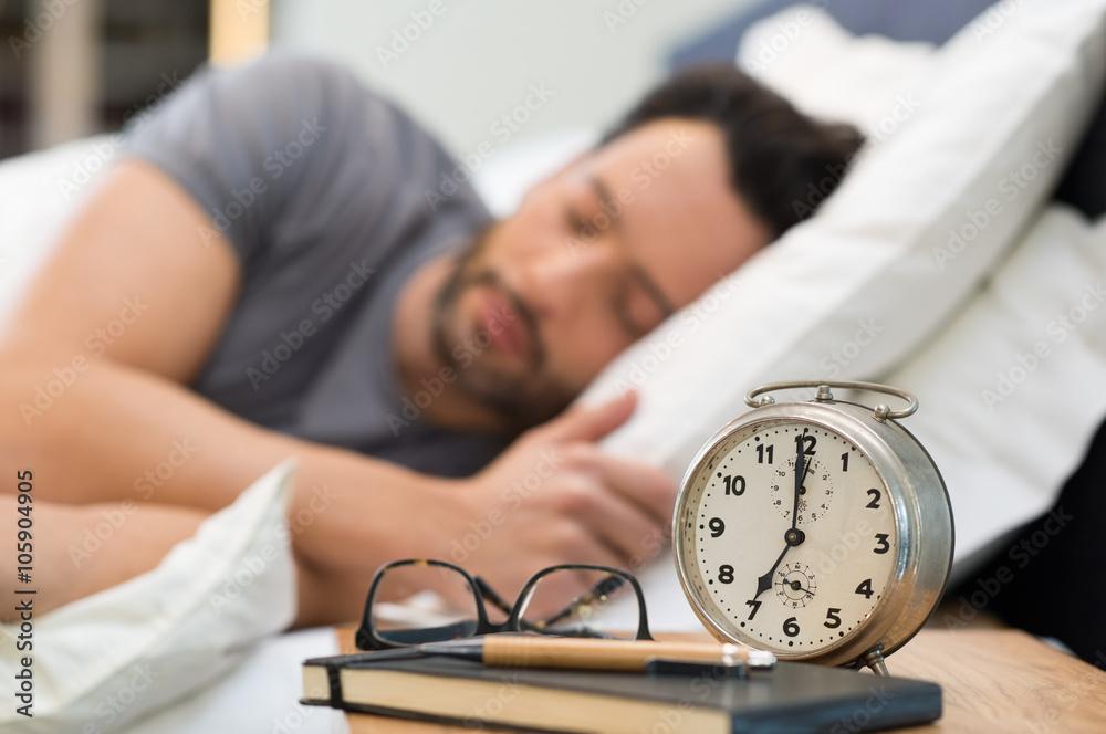 Fototapeta Man sleeping in bed