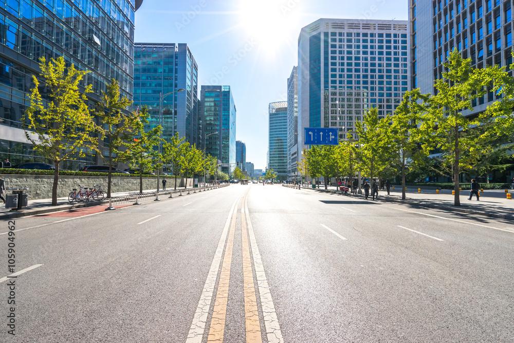 Fototapeta city road through modern buildings in beijing