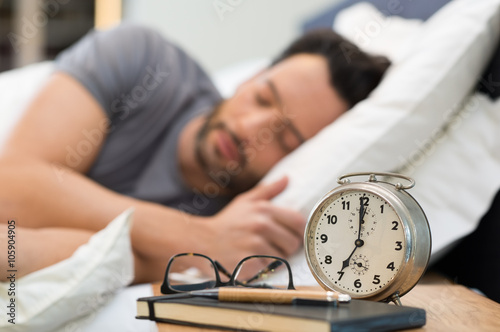 Obraz Man sleeping in bed - fototapety do salonu