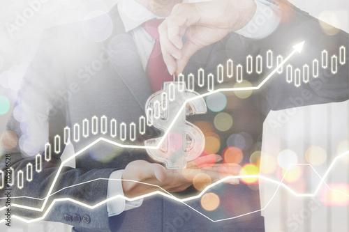 Fotografía Businessman saving money with finance of stock market chart background